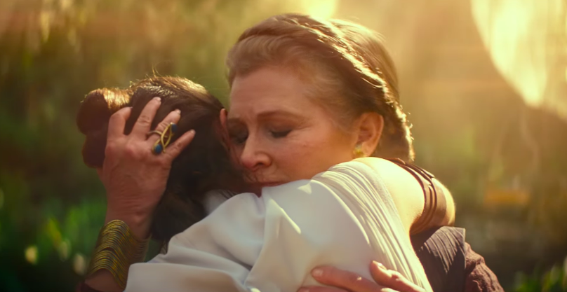 FACE THE FEAR. General Leia Organa (Carrie Fischer) hugs Rey as she faces the battle ahead of her.