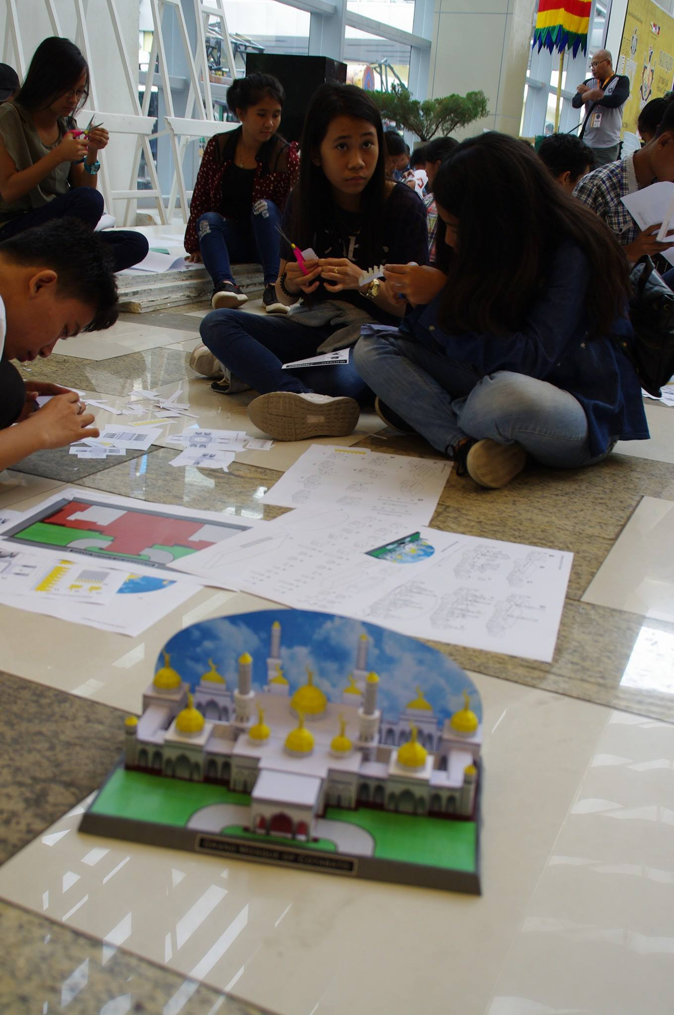 PAPER ART. Students make paper craft. On the foreground is a paper craft of the Grand Mosque in Cotabato City. Photo by Leon Pangilinan Jr/NCCA