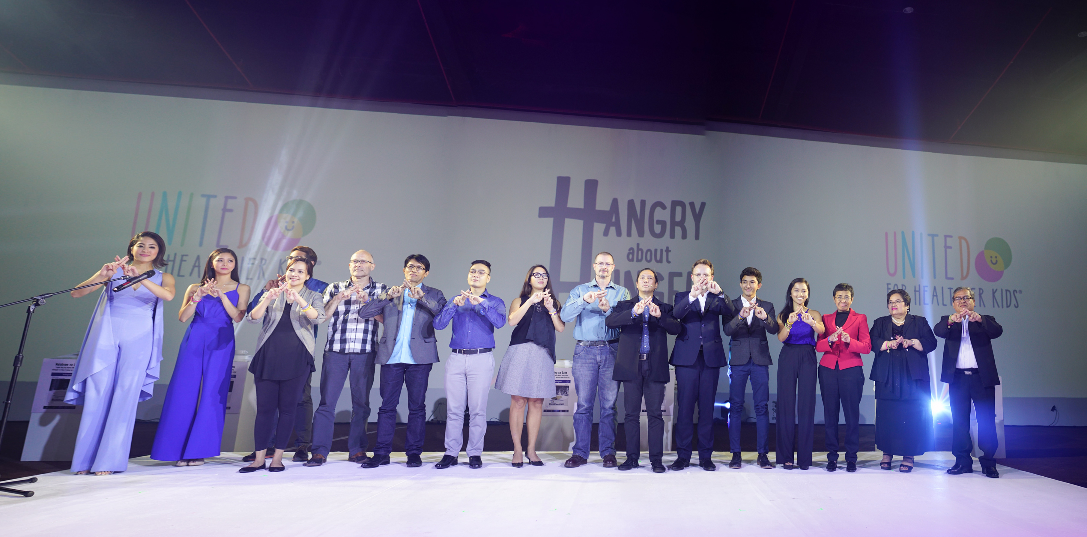 ALL IN. Nestlu00e9 Philippines' top executives join U4HK's partners for the symbolic commitment pledge at the United for Healthier Kids forum on malnutrition onstage.