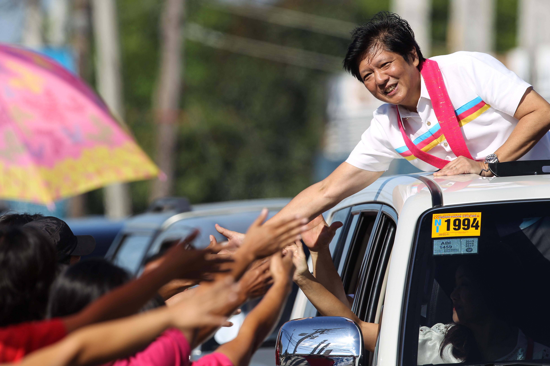 ILOCOS SCION. Senator Ferdinand 'Bongbong' Marcos Junior, running for vice president, greets supporters during a motorcade in Ilocos Norte province. Photo by Mark Cristino / EPA