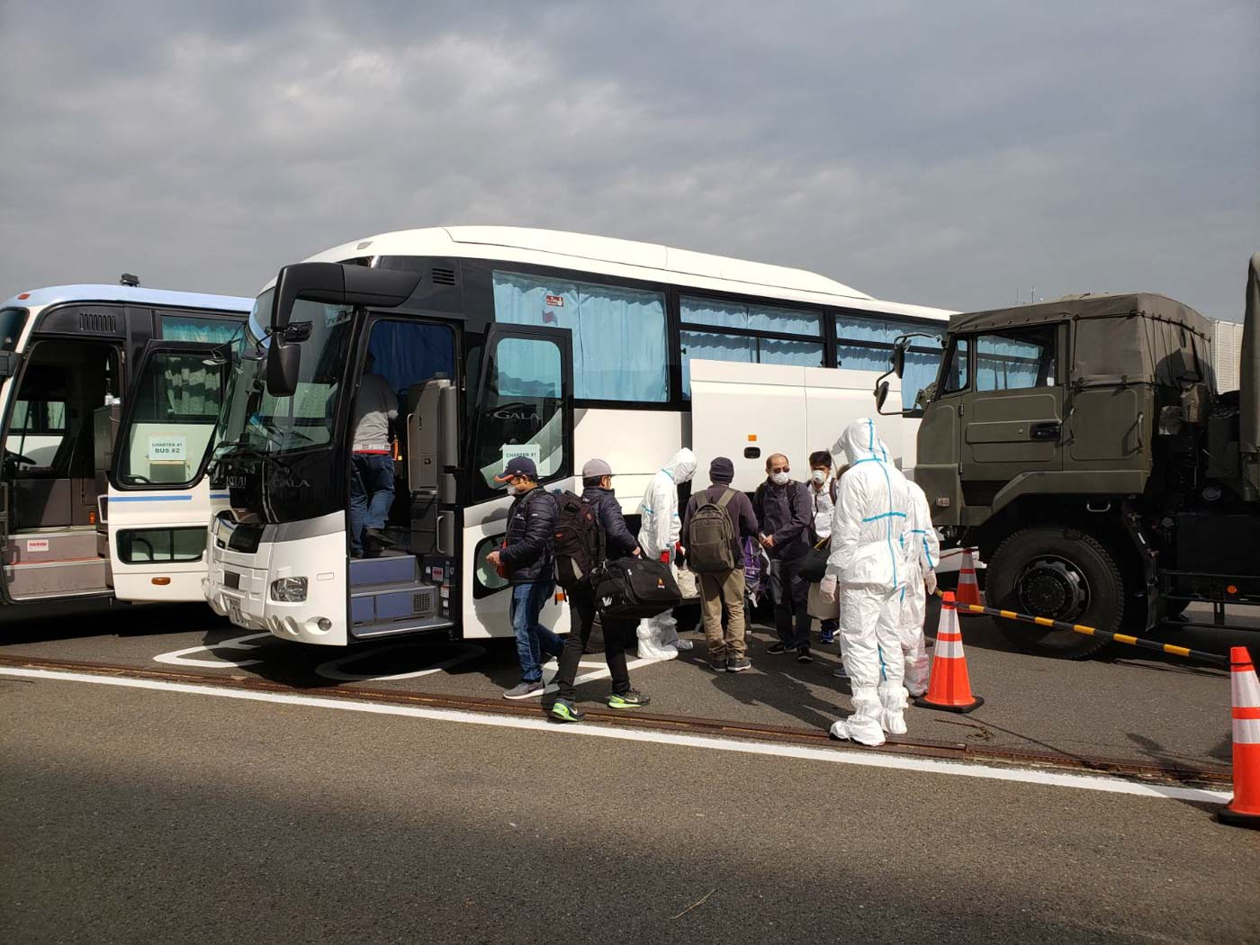 OFF TO THE AIRPORT. Filipinos from the cruise ship board buses to the Haneda Airport. They are assisted by teams from the DFA, DOH, and Japanese officials. Photo from the Department of Foreign Affairs