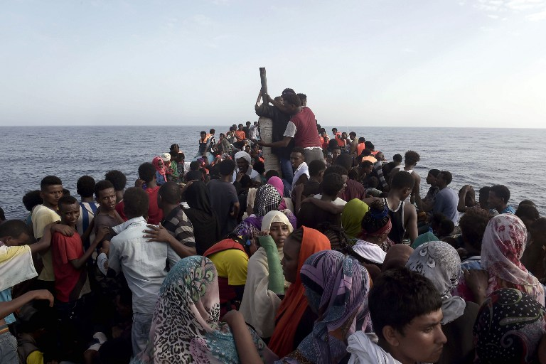 SHIP PATROLS SUSPENDED. This file photo shows refugees and migrants waiting to be rescued by members of Proactiva Open Arms NGO in the Mediterranean Sea, some 12 nautical miles north of Libya, on October 4, 2016. File photo by Aris Messinis/AFP