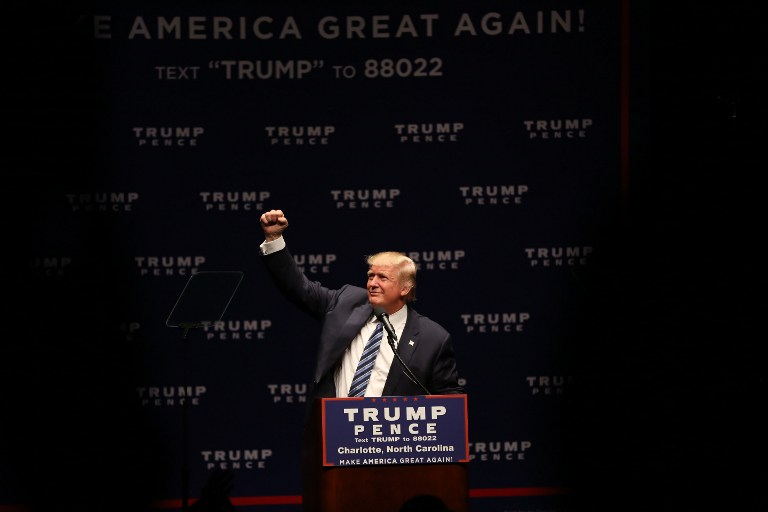 STILL IN. Republican Presidential nominee Donald Trump gestures while speaking to a crowd of donors at the McGlohon Theatre in Charlotte, North Carolina on October 26, 2016. Logan R Cyrus/AFP