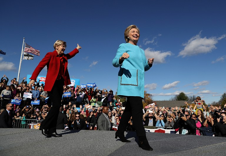 'NASTY WOMEN' Democratic presidential nominee former Secretary of State Hillary Clinton (R) and U.S. Sen. Elizabeth Warren (D-MA) greet supporters during a campaign rally at Saint Anselm College on October 24, 2016 in Manchester, New Hampshire. Justin Sullivan/Getty Images/AFP