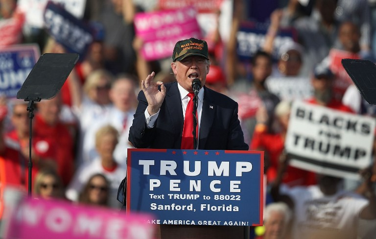 Republican presidential candidate Donald Trump speaks during a campaign rally at the Million Air Orlando, which is at Orlando Sanford International Airport on October 25, 2016 in Sanford, Florida. Joe Raedle/Getty Images/AFP