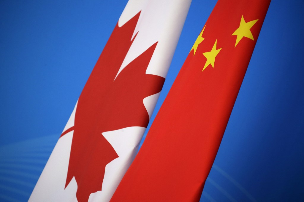 CHINA-CANADA RELATIONS. This file photo shows the flags of Canada and China during the first China-Canada economic and financial strategy dialogue in Beijing on November 12, 2018. File photo by Jason Lee/Pool/AFP