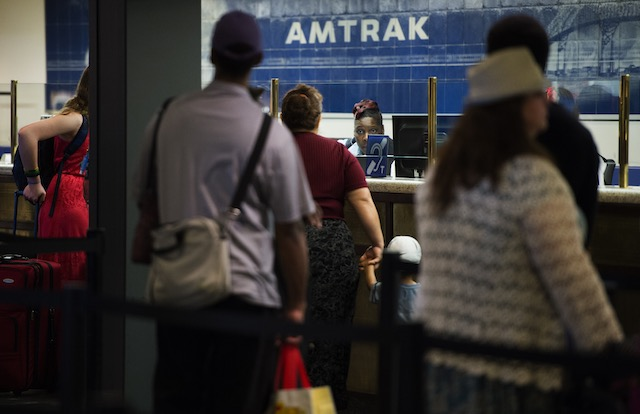 Travelers stand in line for tickets and information at the Amtrak desk at Union Station in Washington, DC, USA, May 13, 2015. Shawn Thew/EPA