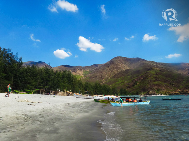 PICTURESQUE SHORELINE. Beach, mountains, and trees make a picturesque mix in Nagsasa