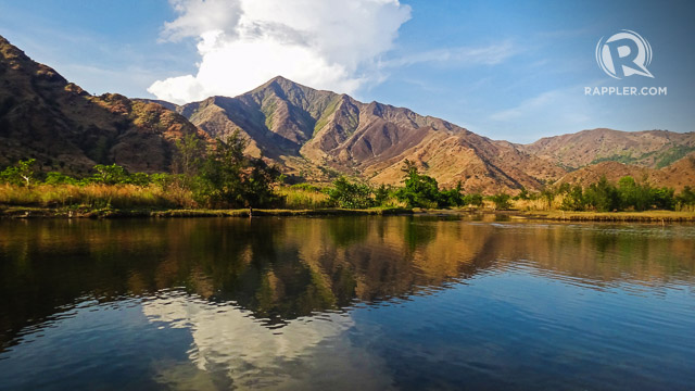 QUIET LAKE AND MOUNTAINS. Afternoon is also the best time to trek inland and see the golden mountains beautifully reflected on Nagsasau2019s quiet lake