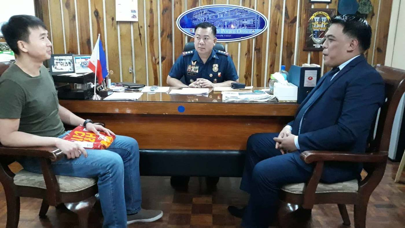 CONSULTATION. Dexteru00a0Dormitoriou00a0(left), brother of Darwinu00a0Dormitorio, who was tortured by fellow cadets at the Philippine Military Academy, and family lawyer Adrian Bonifacio meet withu00a0Baguio City acting police chief Allen Rae Co on October 3, 2019, as they prepare to file murder complaints against suspects in Darwin's death. Photo by Mau Victa/Rappleru00a0