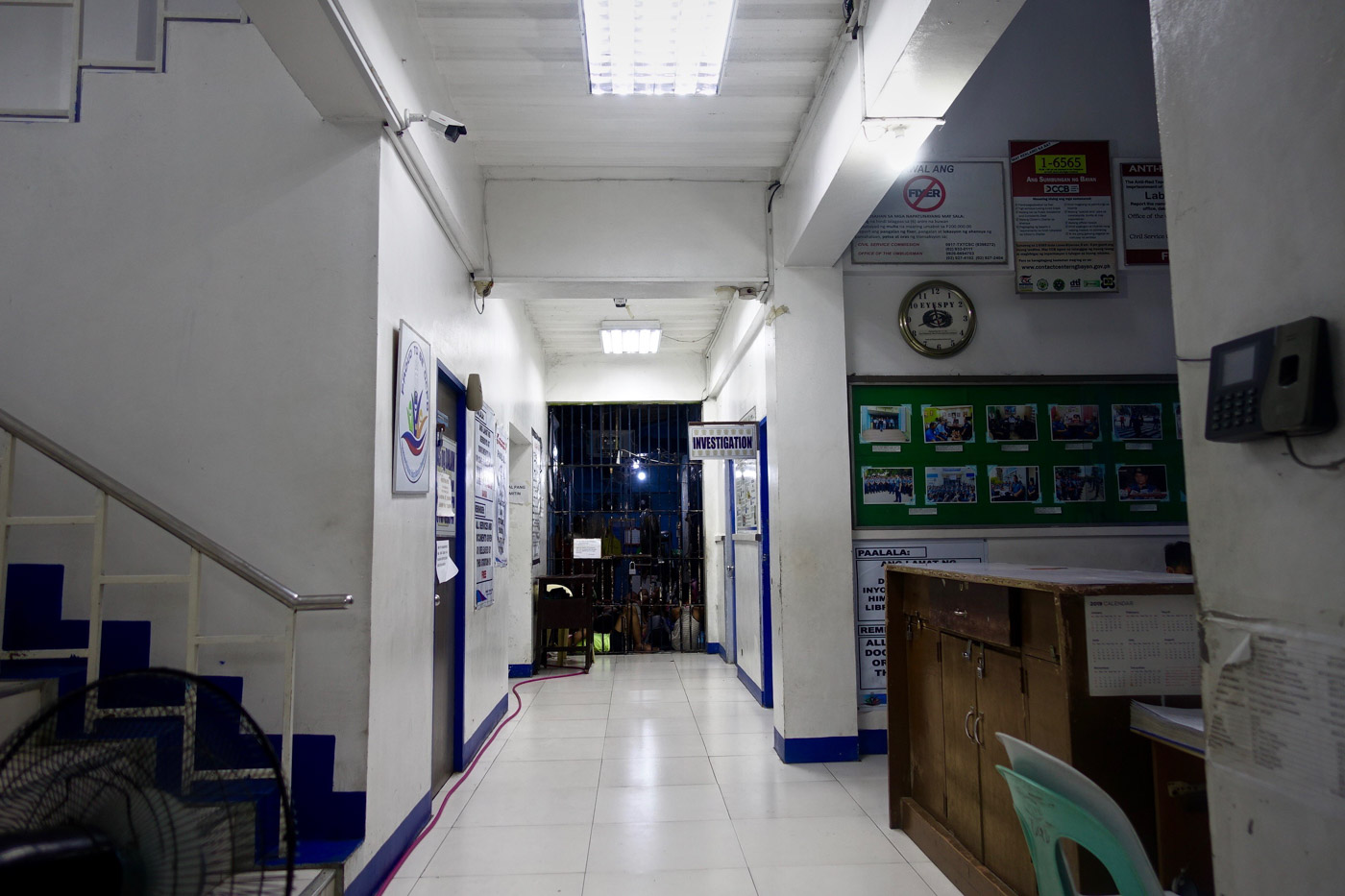ADULTS ACROSS. The detention facility of the Batasan police station is just across the hall from the women and children protection desk. Photo by Rambo Talabong/Rappler