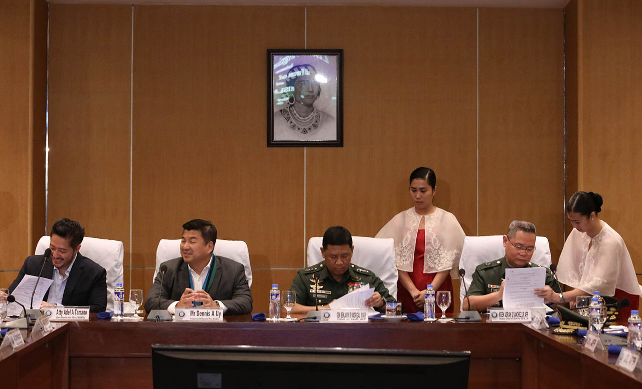 UP FOR SCRUTINY. Defense Secretary Delfin Lorenzana said he would u0022scrutinize carefullyu0022 a deal allowing the China-backed Dito telecommunity to set up facilities in Philippine military installations. Photo of the ceremonial signing of the agreement between at Camp Aguinaldo in Quezon City on Wednesday, Sept. 11, 2019. Photo by Darren Langit/Rappler