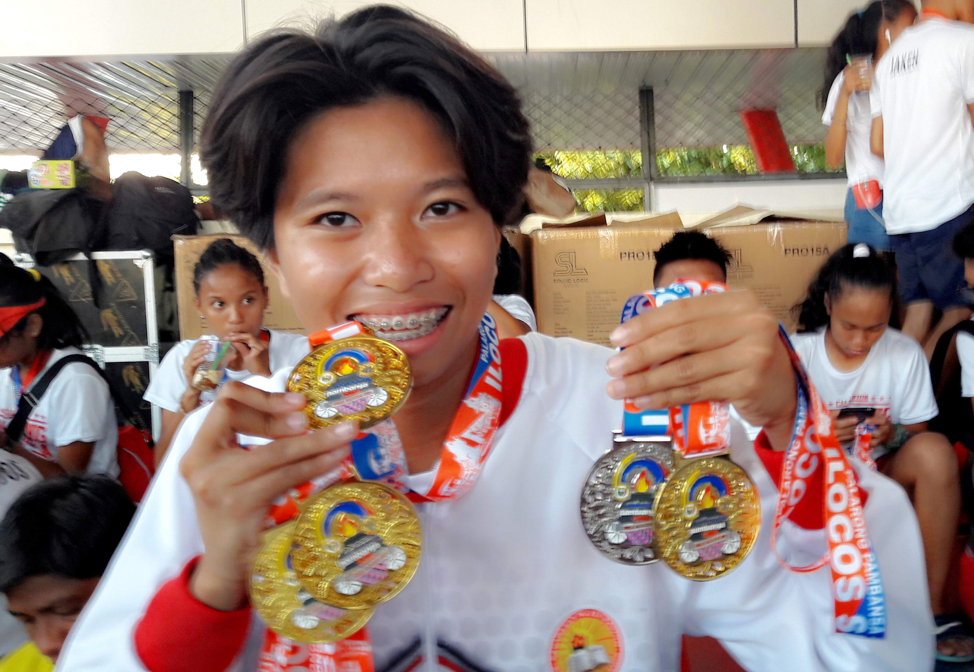 GOLDEN GIRL. Jessel Lumapas collects 4 gold medals and a silver in athletics. Photo by Mau Victa/Rappler