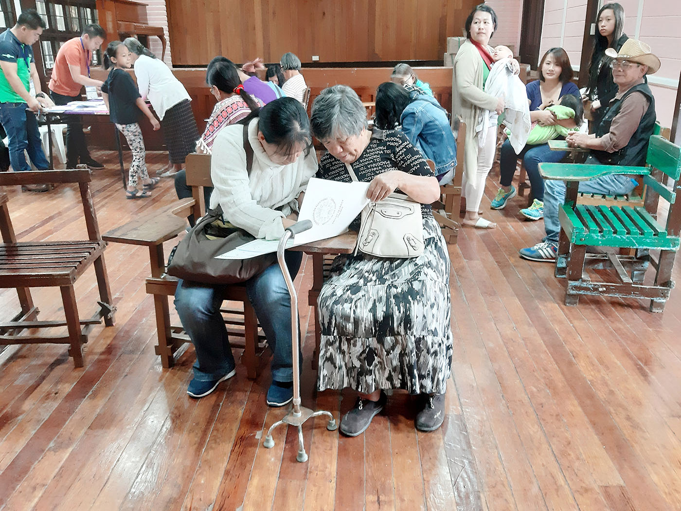 BAGUIO CITY. Visually-impaired individuals cast their vote with the help of their relatives on Monday, May 13. Photo by Mau Victa/Rappler