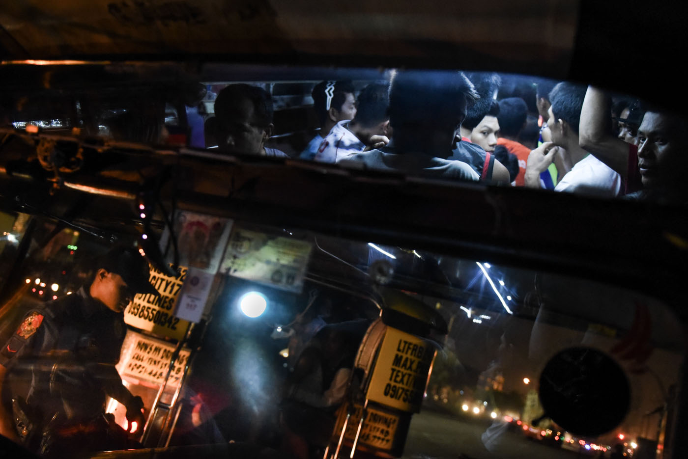 JAMPACKED. More than 20 individuals ride a jeepney meant for only 14 passengers.