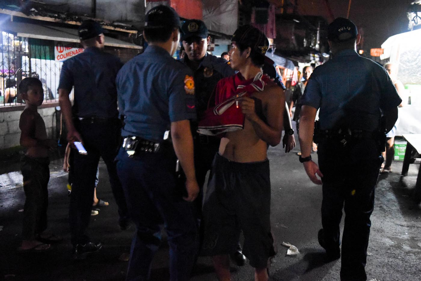 NOT ALL ARE DRUG SUSPECTS. Bystanders and shirtless men are 'invited' by the police for 'validation.'