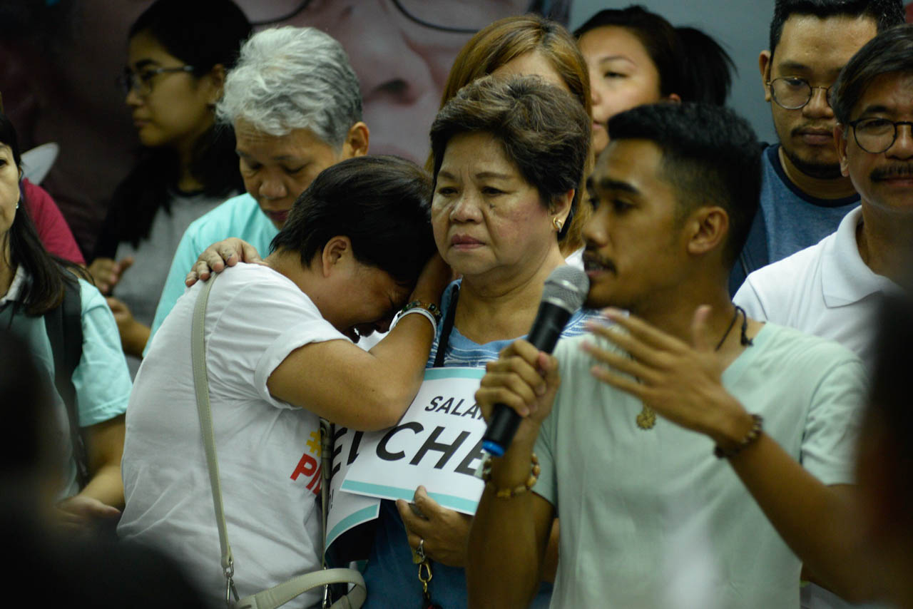 SAD SUPPORTER. A middle-aged woman who campaigned in the streets Chel Diokno breaks down as she expresses her frustration over his electoral loss.