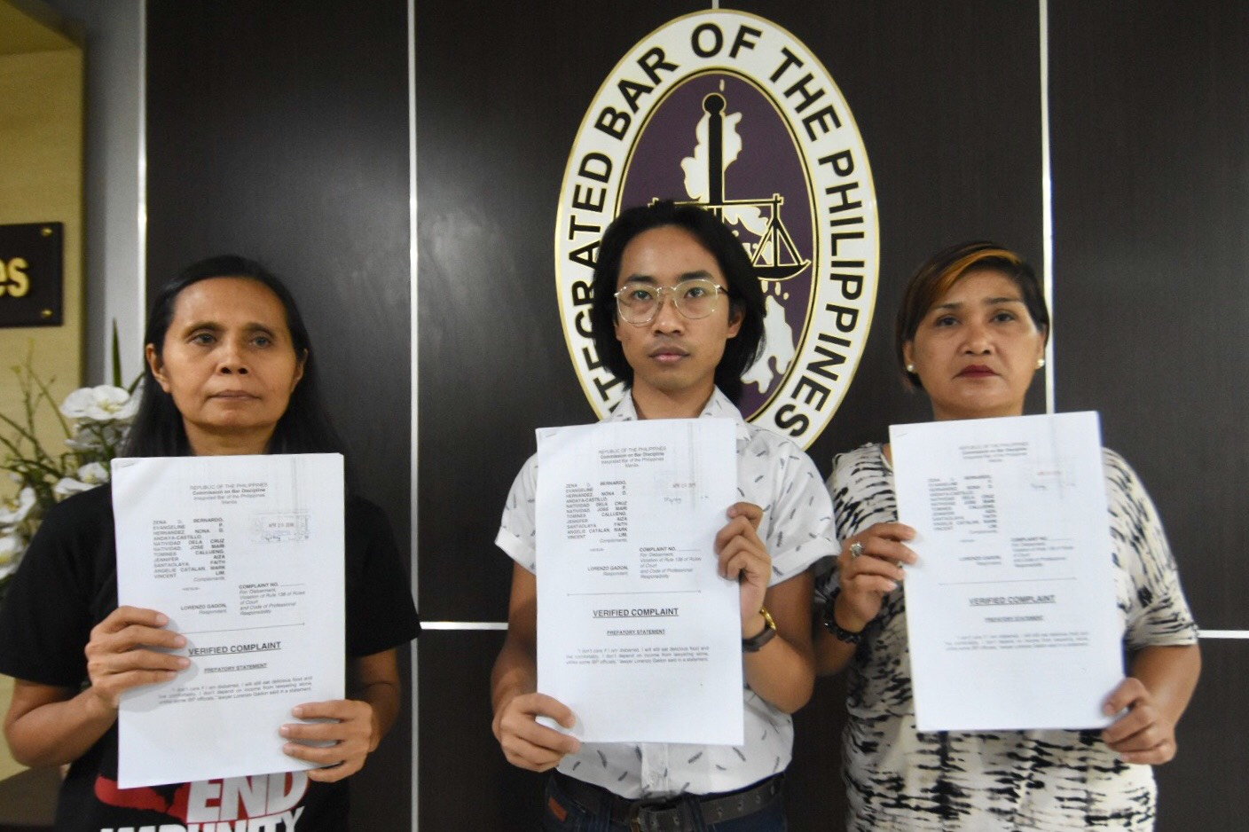 ANOTHER DISBARMENT COMPLAINT. (L-R) Nona Andaya-Castillo, Jose Mari Callueng, and Natividad dela Cruz Natividad hold up their group's disbarment complaint against Larry Gadon filed before the Integrated Bar of the Philippines. Photo by Angie de Silva/Rappler