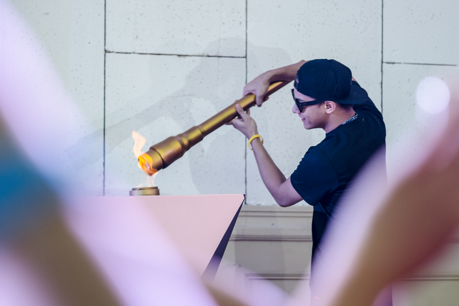 Daniel Padilla lights the torch to start the annual Star Magic Olympics. Photo by Rob Reyes/Rappler