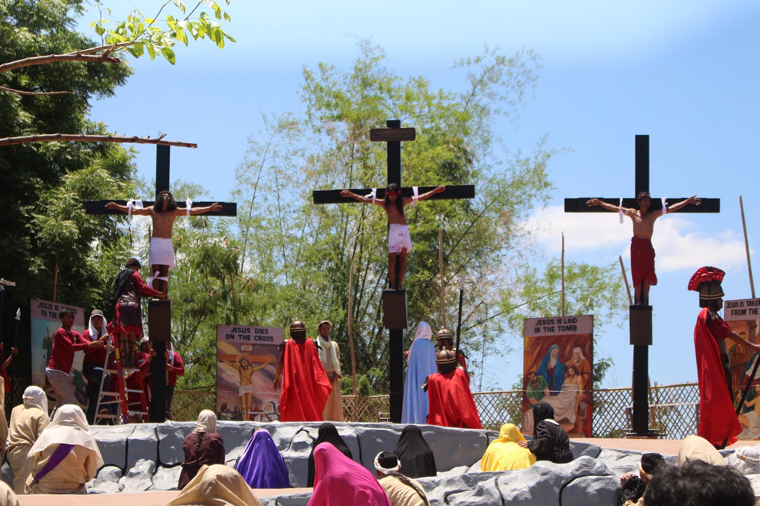 BLOODY PRACTICE. Devotees are nailed to the cross during Good Friday crucifixion reenactment in Sta Lucia, Barangay San Pedro, Pampanga. Photo by Darren Langit