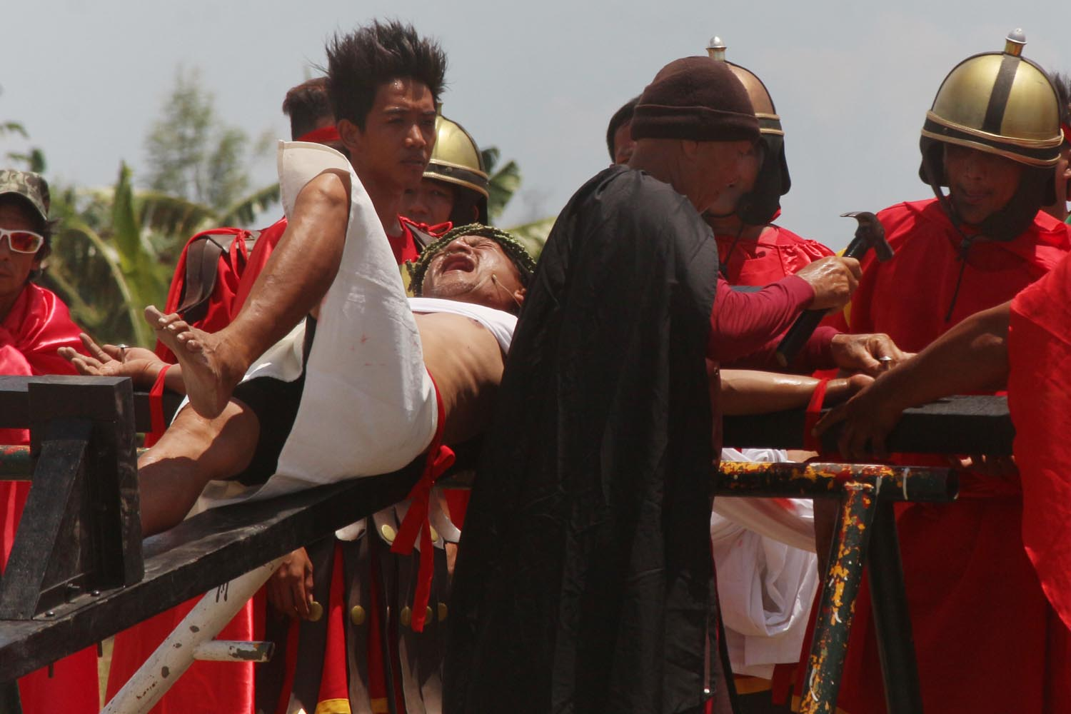 CHRIST'S SUFFERING. Ruben Enaje grimaces as he is nailed to the cross for the 31st time. Photo by Darren Langit