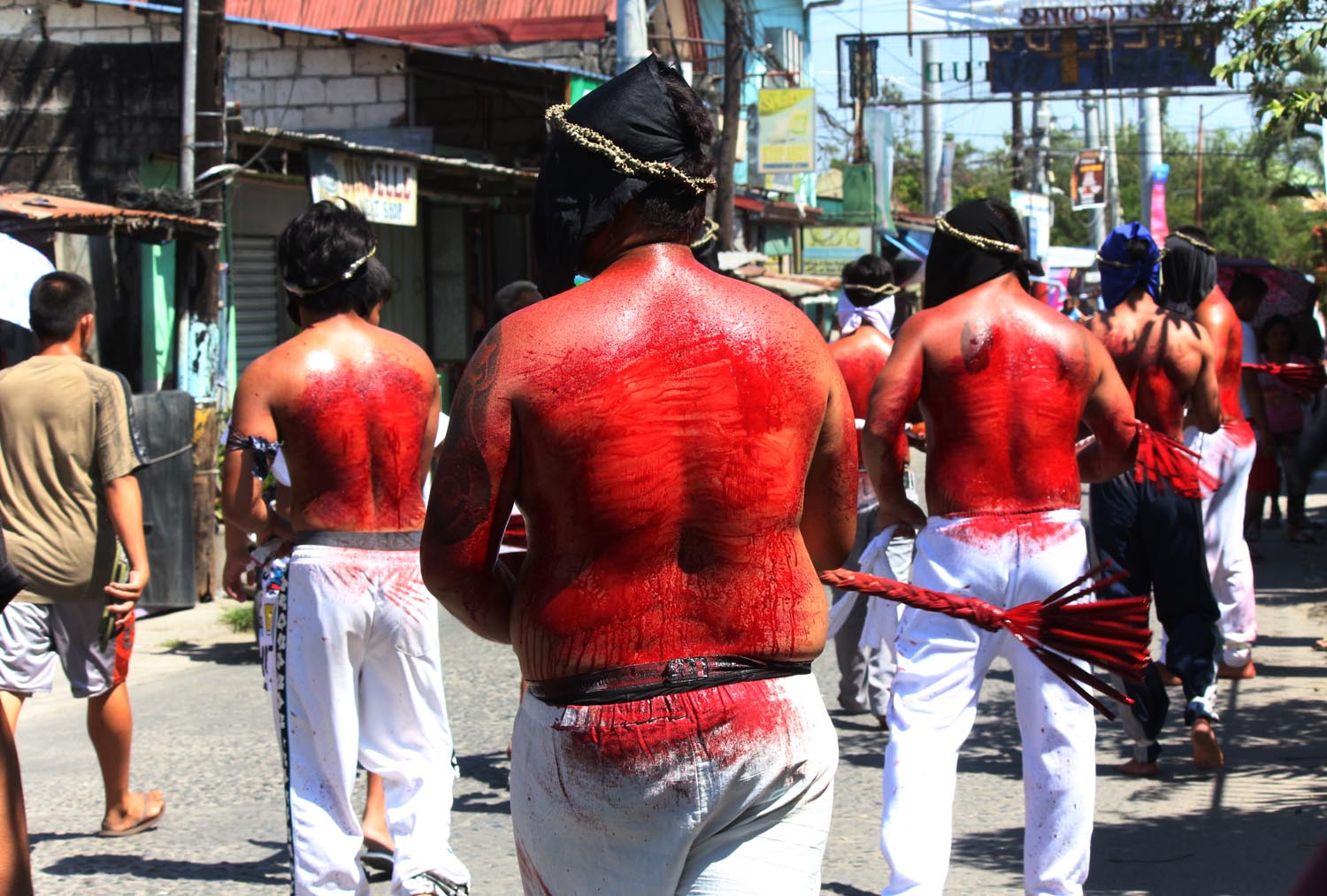 ATONEMENT. Devotees whips their body during a Good Friday ritual to atone for their sins. Photo by Darren Langit