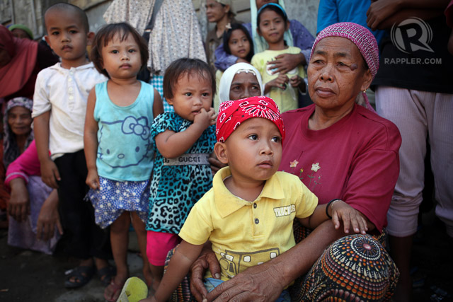 WAITING. Children affected by the conflict in the village of Tukanalipao, Mamasapano, Maguindanao are seen with their parents waiting for the distribution of relief assistance. Photo by Jeoffrey Maitem