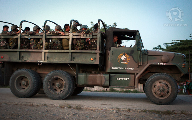 REINFORCEMENT. Government troops arrive in Mamasapano, Maguindanao after dozens of elite policemen under PNP-SAF were killed following a clash with Moro rebels on January 25, 2015. Photo by Jeoffrey Maitem