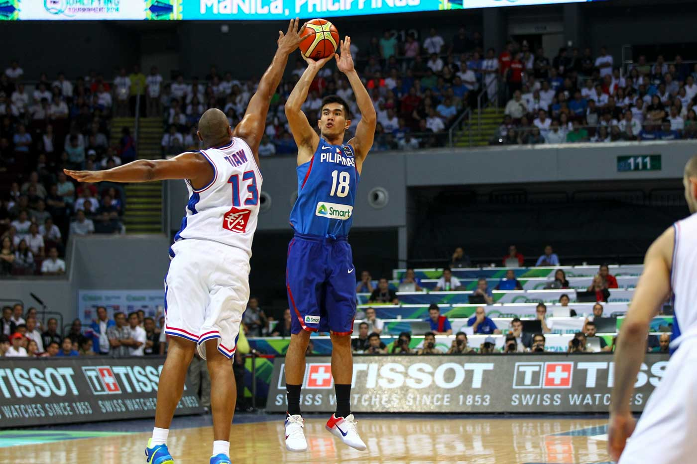 Troy Rosario of the Philippines puts up a jumper against France's Boris Diaw. Photo by Josh Albelda/Rappler