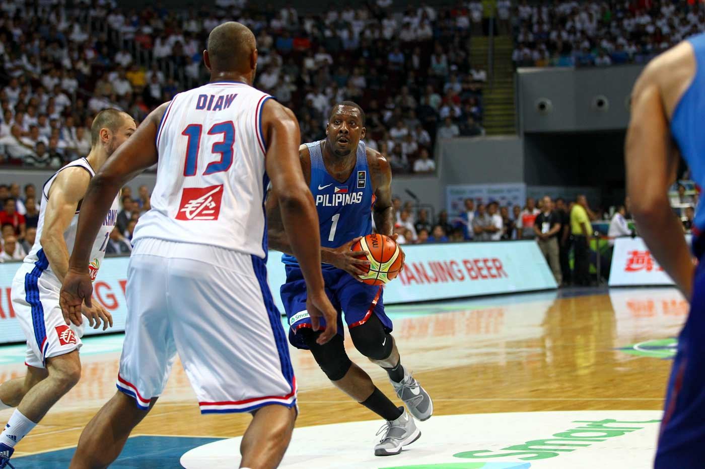 Andray Blatche of the Philippines drives to the rim against Boris Diaw of France. Photo by Josh Albelda/Rappler