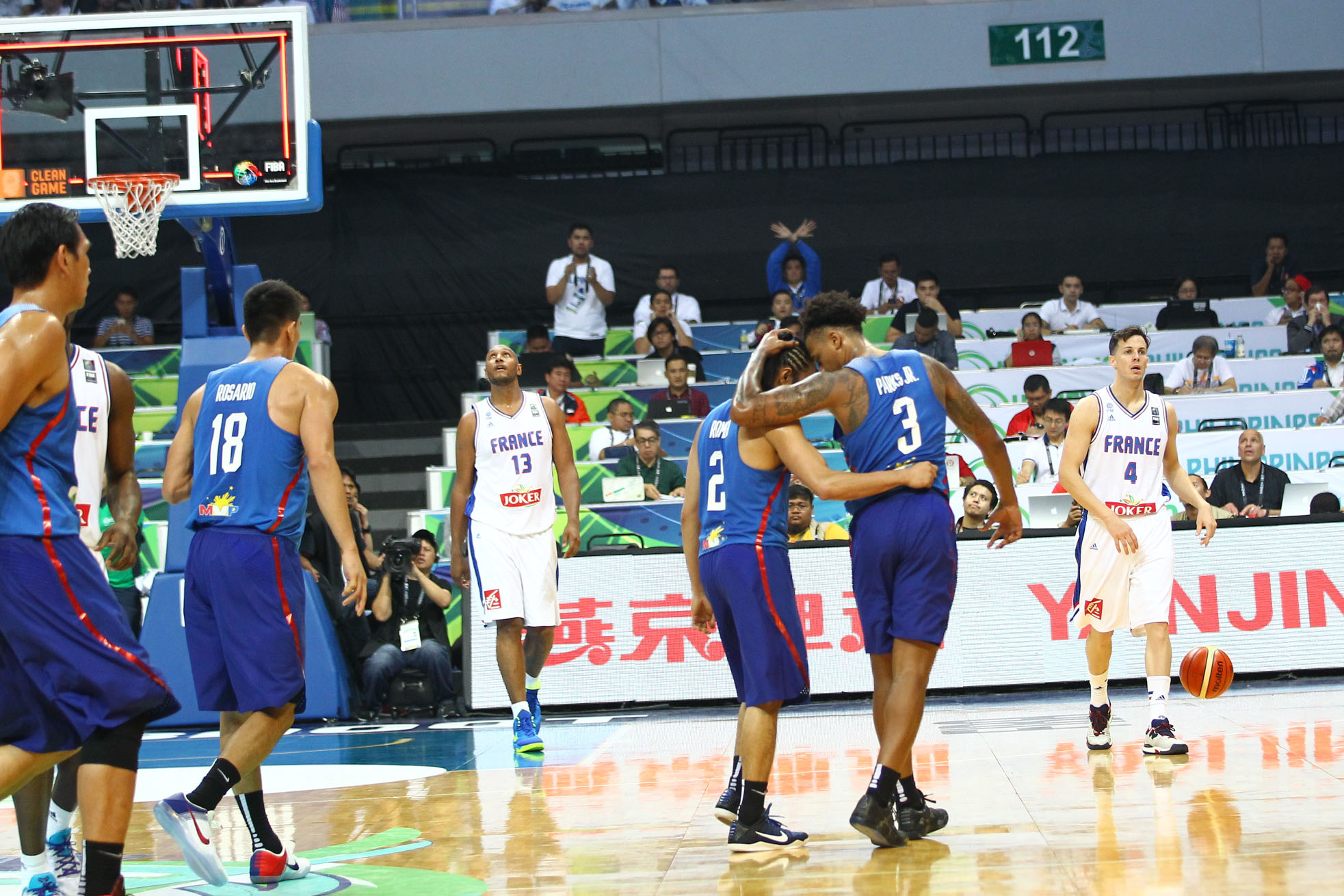 Ray Parks Jr and Terrence Romeo share a moment late in the game against France. Photo by Josh Albelda/Rappler
