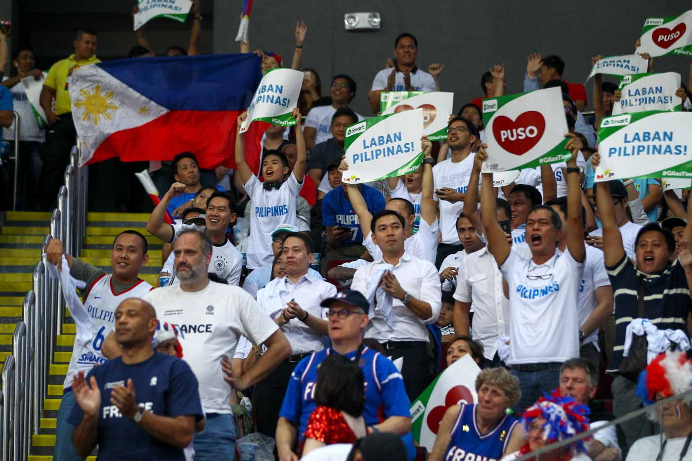 Filipino fans cheer on Gilas Pilipinas in their opening match of the FIBA Olympic Qualifying Tournament. Photo by Josh Albelda/Rappler