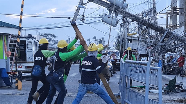 ROUND THE CLOCK. Linemen of Aklan Electric Cooperative (AKELCO) Task Force Kapatid-Ursula at work. Photo by AKELCO