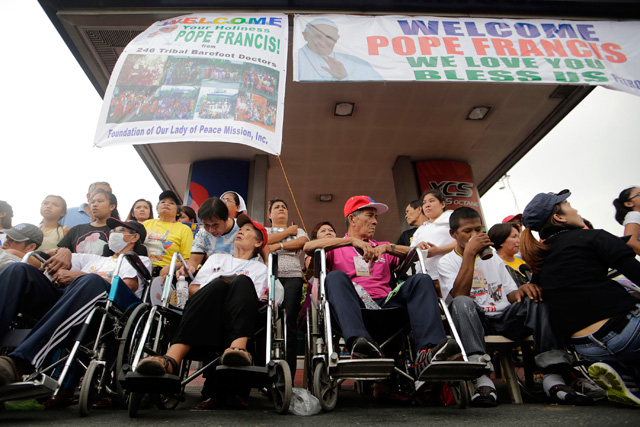 EQUAL ACCESS. Person with disabilities (PWD) await the arrival of Pope Francis in Manila on January 15, 2015. Photo by Ritchie Tongo/EPA