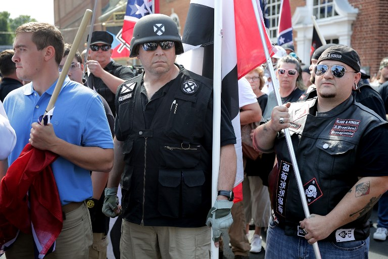FIGHTING FOR THEIR 'RIGHTS' Hundreds of white nationalists, neo-Nazis and members of the 'alt-right' march down East Market Street toward Emancipation Park during the u0022Unite the Rightu0022 rally August 12, 2017 in Charlottesville, Virginia. Chip Somodevilla/Getty Images/AFP