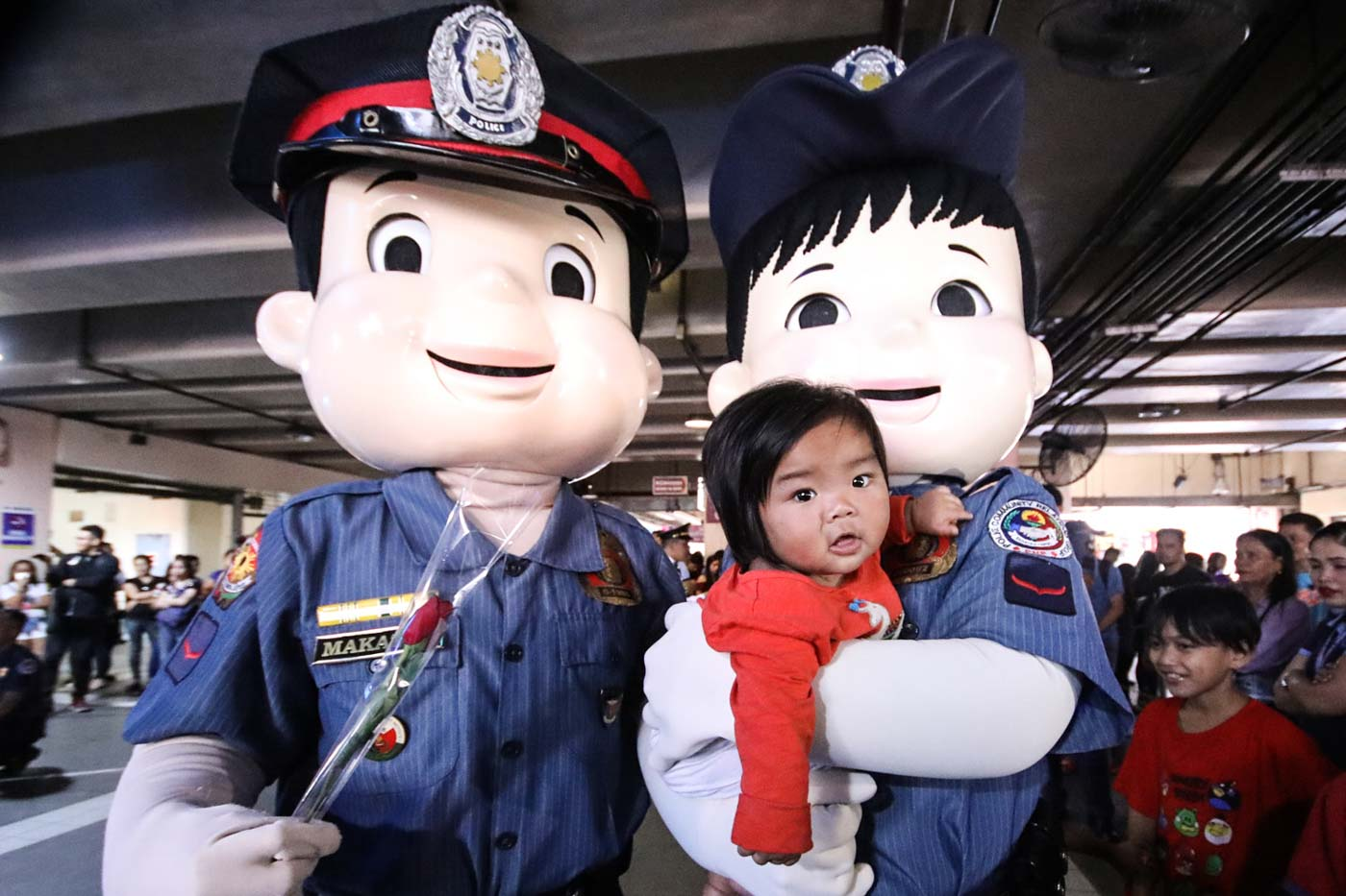 MASCOTS FOR KIDS. The Philippine National Police brings out mascots to surprise kids, too. Photo by Darren Langit/Rappler