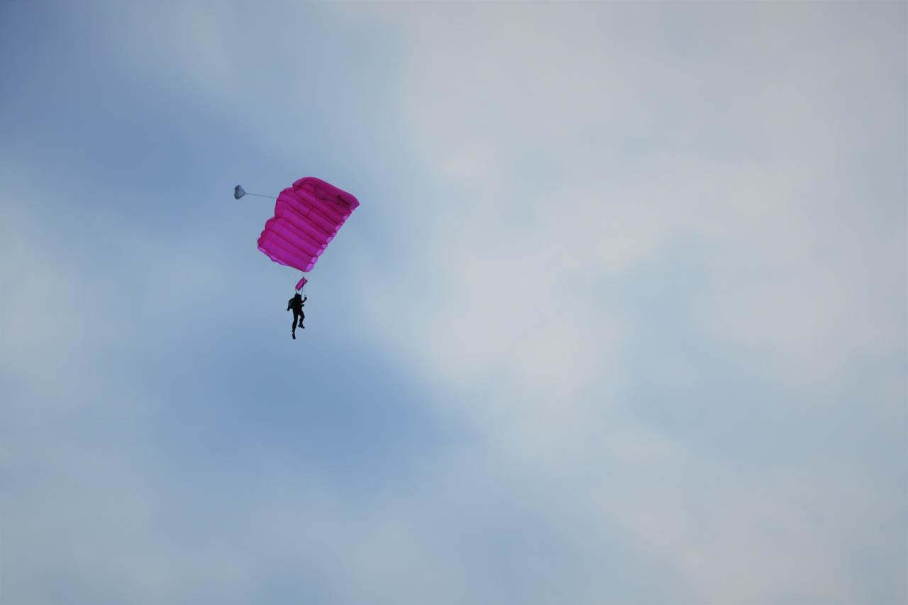 AIRBORNE. Fr. Mario Beltran Patangan in the air on his pink parachute. Photo by Gualberto Laput