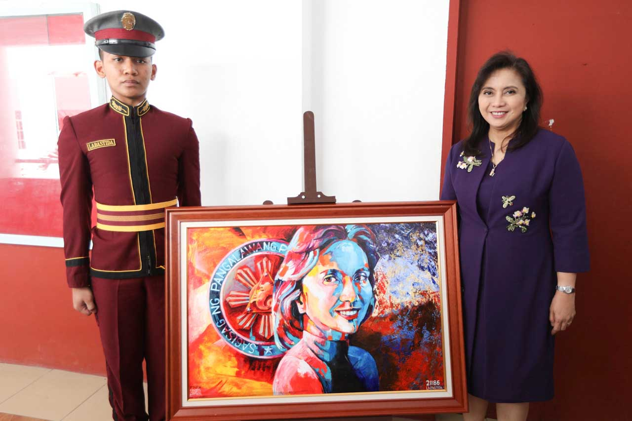 GIFT TO THE VEEP. Vice President Leni Robredo poses with graduating PNPA student Cadet 4CL Don Carlo Labastida, who gifted her with a portrait painting. All photos by OVP