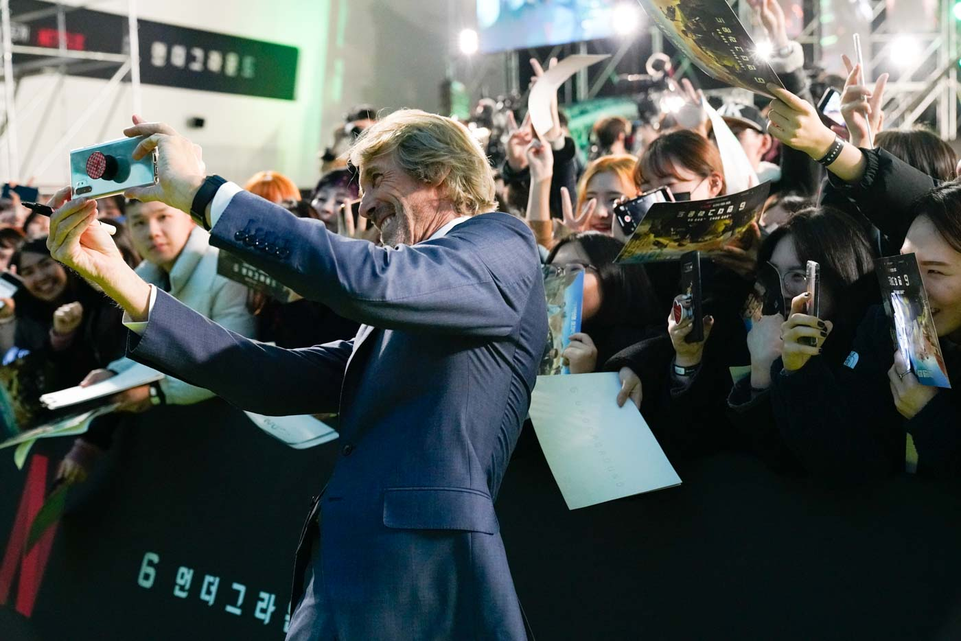 Lucky fans: 6 Underground director Michael Bay holds up the phone for a selfie with fans at the world premiere of his Netflix movie at Dongdaemun Design Plaza on December 02, 2019 in Seoul, South Korea. Photo courtesy of Netflix