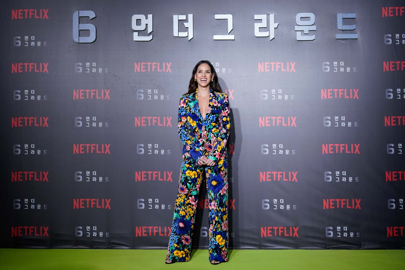 Enjoying Korea: Adria Arjona gives fans a bright smile despite the chilly weather in Seoul, South Korea at the world premiere of Netflix's '6 Underground' at Dongdaemun Design Plaza on December 02, 2019. Photo courtesy of Netflix