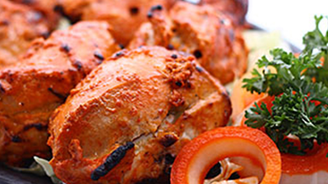 CHICKEN TANDOORI. Grilled chicken marinated with Indian spices. Photo courtesy of Queens at Bollywood's website