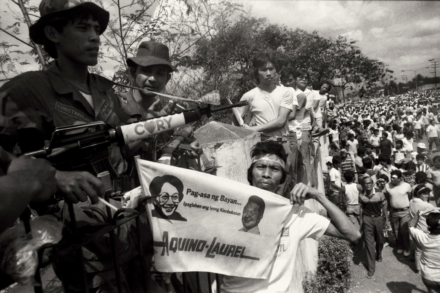 CIVILIAN-BACKED MILITARY REVOLT. Filipinos oust the Marcos dictatorship on February 25, 1986. File photo by Romeo Mariano