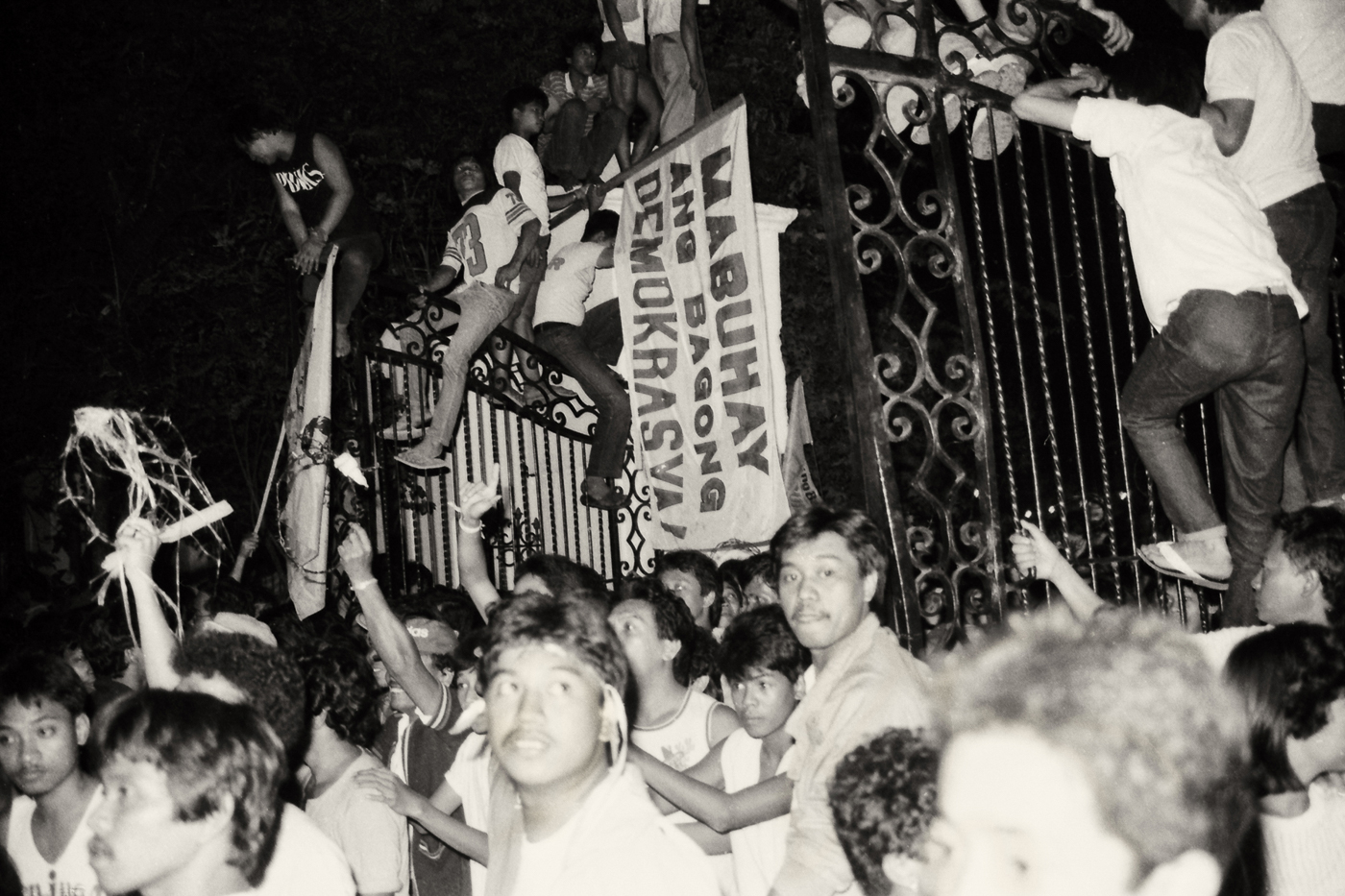 STORMING THE PALACE. Upon hearing news that Marcos left the country, people storm the gates of the Malacau00f1an Palace on February 25, 1986. Anger was replaced by joy and renewed hope for a better life.