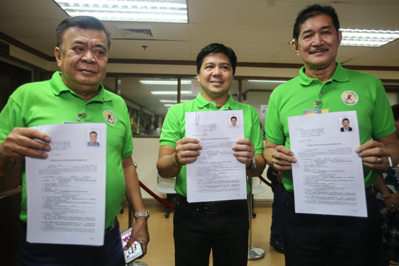 Former Quezon City representative Mike Defensor, along with Emmanuel Andal and Adorlito Ginete, file their certificate of acceptance of nomination under Anakalusugan. Photo by Ben Nabong/Rappler