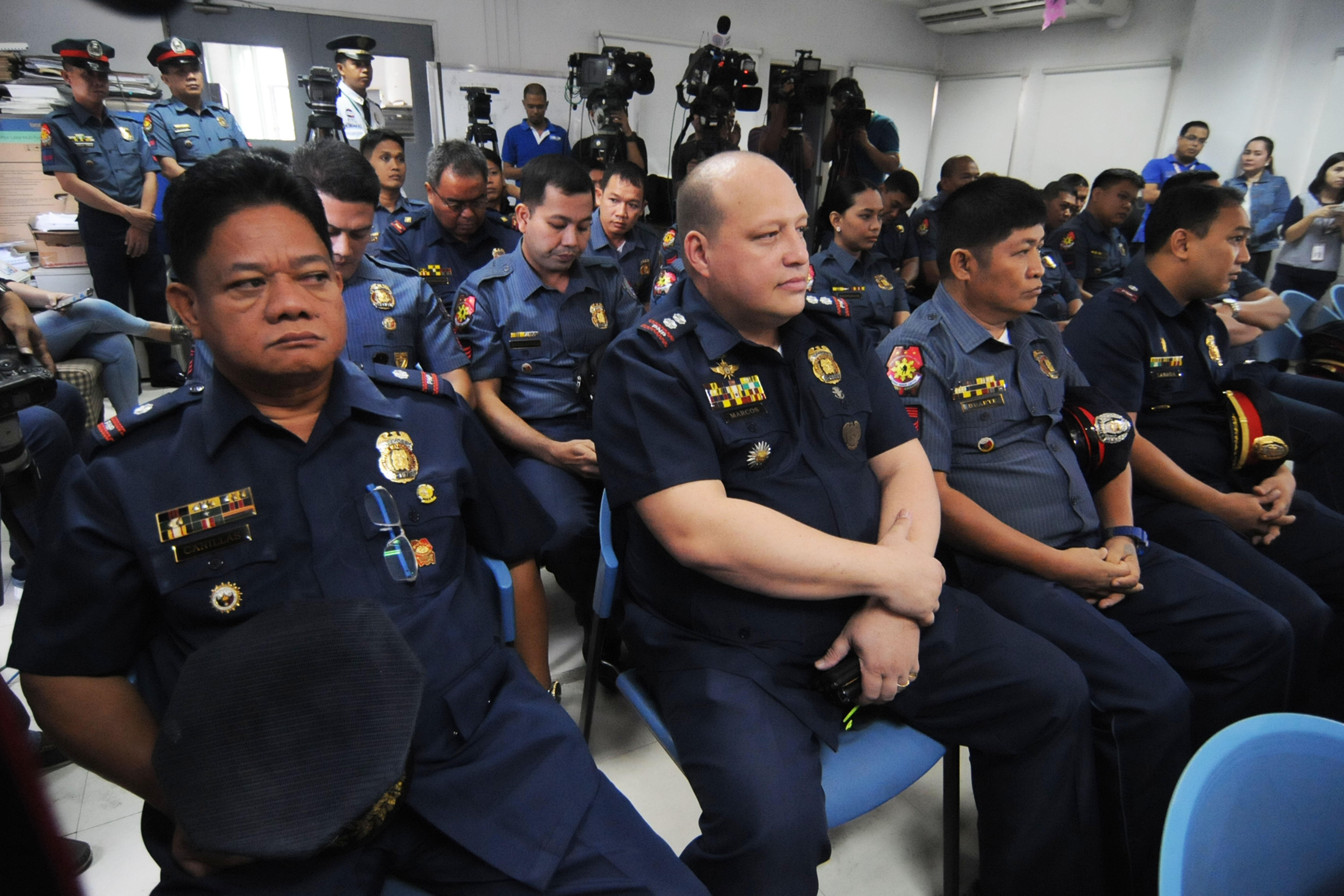 DOJ INQUIRY. Superintendent Marvin Marcos (2nd from left) and other cops tagged in the killing of Albuera Mayor Rolando Espinosa Sr attend the preliminary investigation at the Department of Justice on December 20, 2016. Photo by Ben Nabong/Rappler