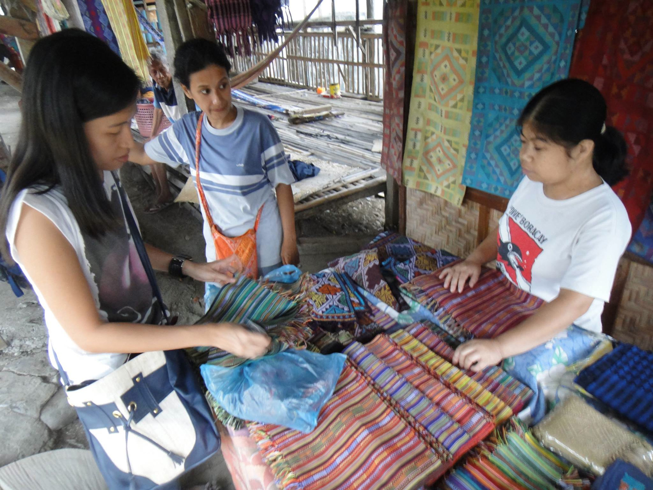 ENCOURAGEMENT. To encourage and retain the weavers who partner with Vesti, Rodriguez shows them bags made out of their textiles. Doing so gives them a sense of pride and belonging.