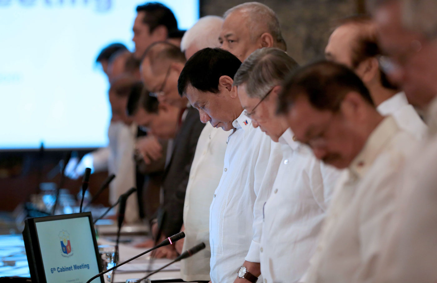 DUTERTE'S OFFICIAL FAMILY. President Rodrigo Duterte and his Cabinet members pray before the start of the 6th Cabinet Meeting in Malacau00f1ang State Dining Room on September 14. Photo by Rey Baniquet/PPD