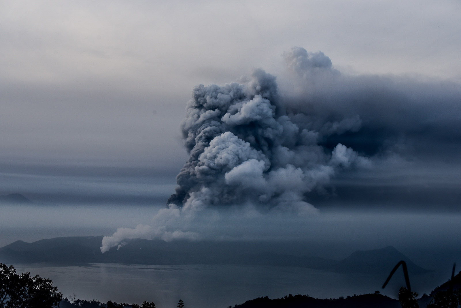 DEATHS IN BATANGAS. A view of Taal Volcano from Tagaytay City as it spews thick clouds of ash on January 13, 2020. Photo by Alecs Ongcal/Rappler