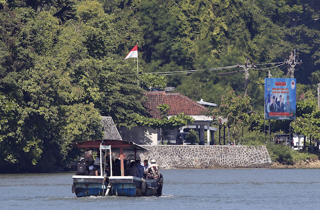 EXECUTION ISLAND. A ferry boat carrying the families of Australian death-row prisoners Myuran Sukumaran and Andrew Chan crosses the water for a visit to Nusakambangan prison island at Wijayapura port in Cilacap, Central Java, in March 2015. Photo by EPA