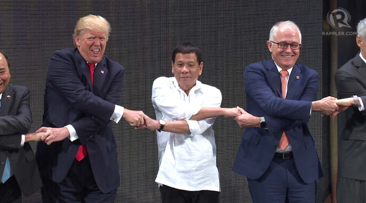 ASEAN HANDSHAKE. The two leaders stand next to each other for the ASEAN handshake, which Trump had trouble executing. Screenshot by Rappler